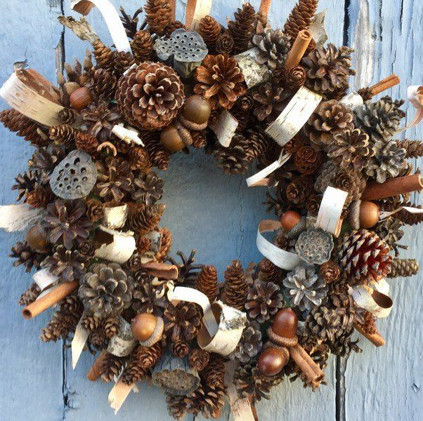 "This wreath contains dozens of different kinds of Pine cones and Acorns. I've also added loops and strips of White Birch bark. I've added Cinnamon as well. It measures 15"" across. This wreath will las"