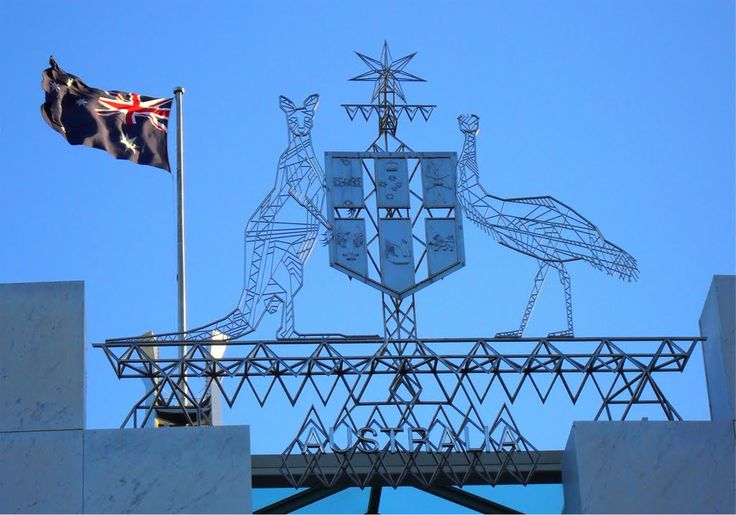 Parliament House Canberra | The Coat of Arms and Flag behind