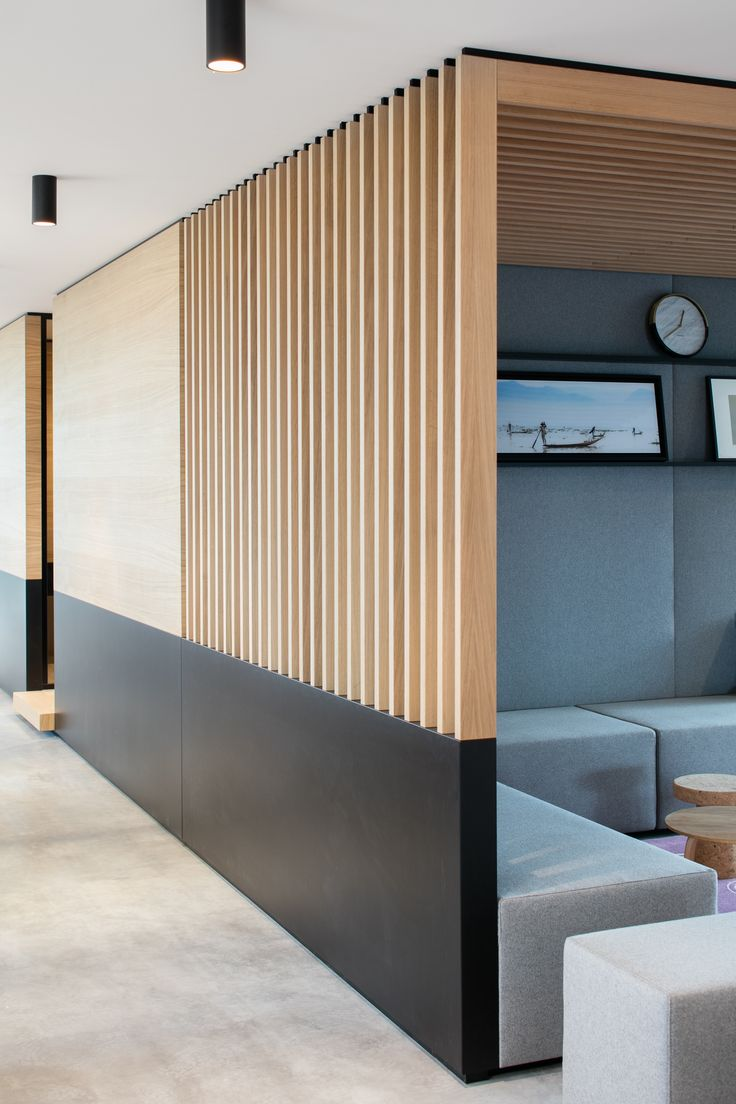 Wood slats and metal acting as a partition in this office space | Décor Aid