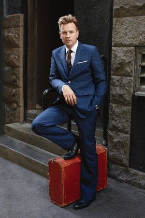 Ewan McGregor in a Paul Smith wool suit and Lanvin cotton shirt; Alexander Olch tie and pocket square; Tiffany & Co. tie bar; Rolex watch; Prada shoes.