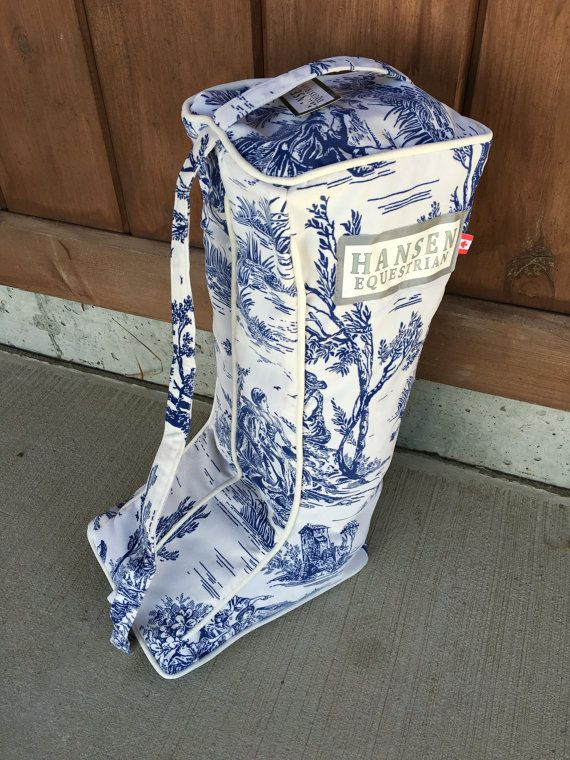 """The all new Hansen Equestrian boot bags are the latest """"must have"""" accessory for any equestrian. At 23 inches tall, they are made to fit all sizes of boots, they have a separate compartment for each boot and a removable bottom panel to help you easily transition from throwing your dirty boots in at the end of along show day to a nice clean bag for your freshly polished boots next weekend. By only having to clean the bottom panel after each show, it reduces the amount of cleaning you will…"""