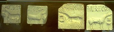 The first objects unearthed from Harappa and Mohenjo-Daro, major sites of the Indus Valley Civilization, were small stone seals inscribed with elegant depictions of animals, including a unicorn-like figure, and marked with Indus script writing which still baffles scholars. These seals are dated back to 2500 B.C