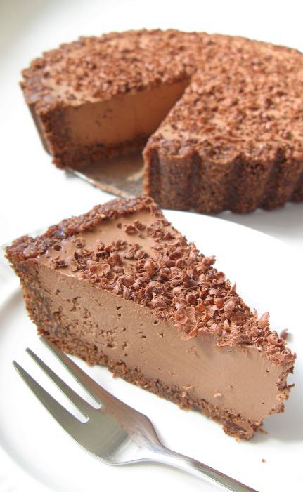 "In our house, this raw vegan chocolate cheesecake is affectionately called ""triple chocolate insanity"". Raw Vegan Chocolate Cheesecake"