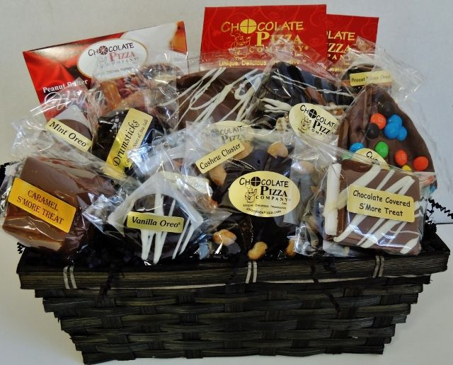 When only the best will do, Chocolate Perfection is the Gift Basket of choice. Loaded with a seemingly endless array of Chocolate Pizza Company's best confections, this Gift Basket will leave them speechless. It includes our famous Peanut Butter Wings™ (16 oz), Chocolate Covered Pretzels (8 oz), Chocolate Covered Potato Chips (8 oz), 3 Chocolate Pizza® Slices (6 oz each), Caramel S'more, S'more Treat, Drumstick, Pecan/Cashew Cluster, 4 Chocolate Covered Oreos®.