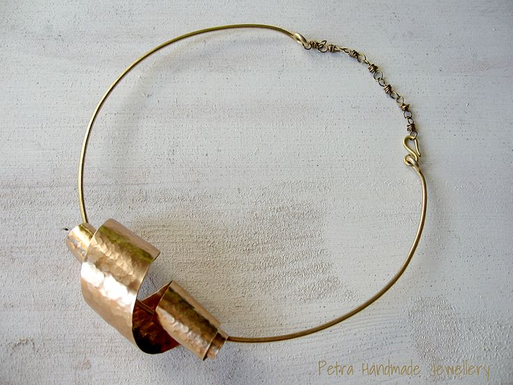 Just a curly coiled brass ribbon to define this necklace simply Petra handmade Jewellery