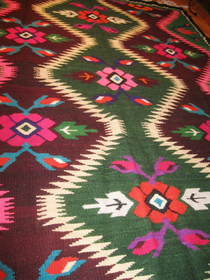 Beautiful antique traditional Romanian / Ukrainian woven wool carpet / rug with both floral and geometrical pattern. Absolutely stunning and vivid colors. Hand woven in Romanian villages closed by Ukrainian borders where are living both Romanians and Ukrainians together, 50 - 60 years ago. Hand woven with wool on cotton thread foundation.  At www.greatblouses.com