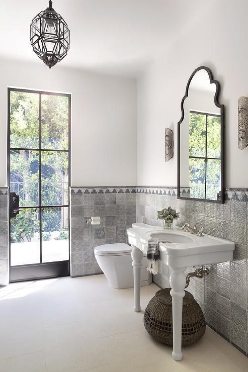 Lit By A Glass And Iron Moroccan Lantern And Natural Light From A Glass  Front Iron Door, This Mediterranean Style Bathroom Features White Walls  Half Covered ... Part 73