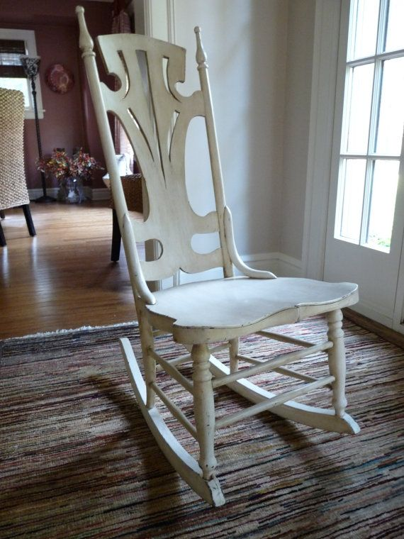 LOVE this vintage rocking chair with the long back, openwork design and lovely chic white paint.