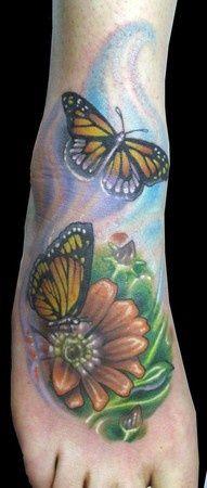 Flowers and Butterflies Foot Tattoo - Christian Perez http://tattoosflower.com/flowers-and-butterflies-foot-tattoo-christian-perez/