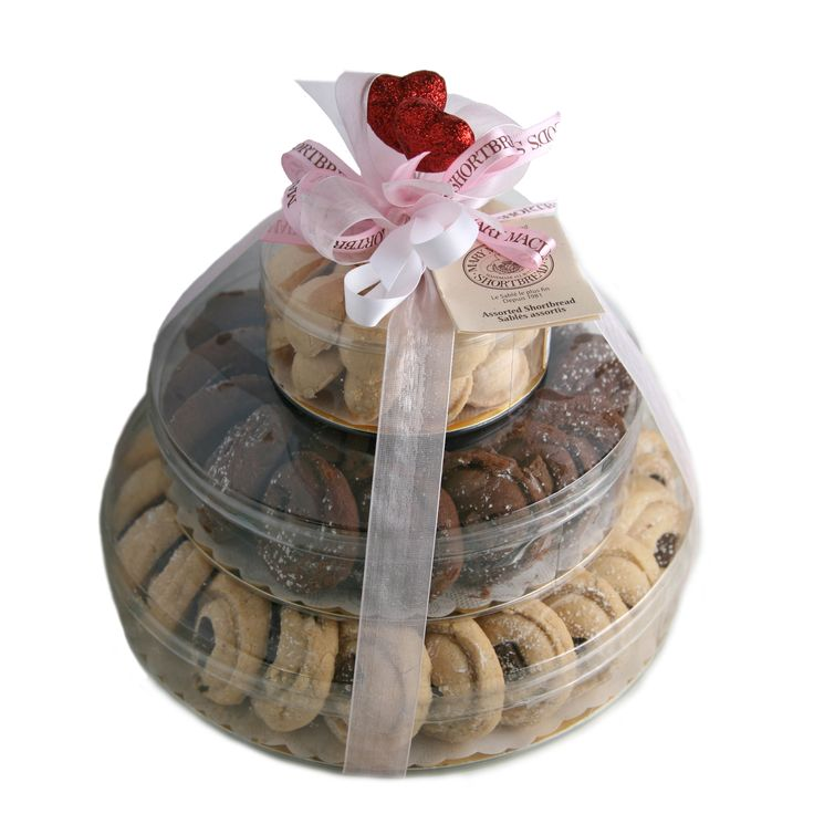 Romantically themed towers of cookies for guests to snack on.