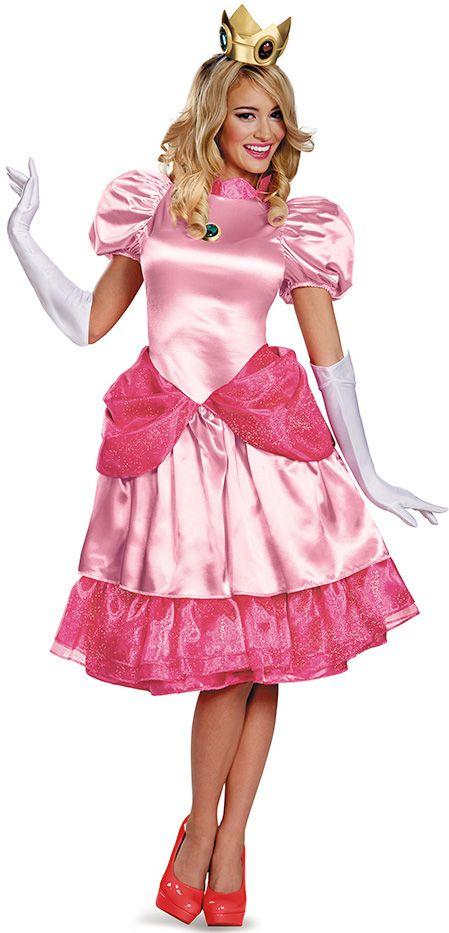 Disfraz Princesa Peach™ mujer: Este disfraz de Princesa Peach™ Deluxe para adulto pertenece a la licencia oficial de Mario™ e incluye un vestido, una enagua y una corona de princesa (guantes y zapatos no incluidos). El...
