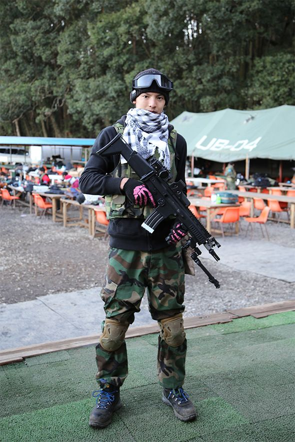 Airsoft Player in Japan. Fashion Photo. Woodland camo pants. Military. Gun. Combat