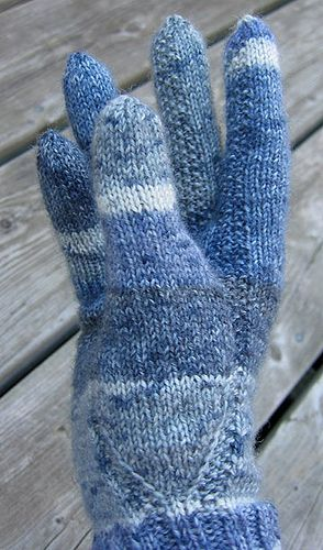 detail from - 'Mairi McK Gloves for arthritic hands -  Gloves for my mother's arthritic hands. Photo shows the seed stitch around the thumb gusset, and up the first two fingers.   It has been fitted for hands with collapsed thumb joints, but this photo shows it on a 'normal' hand, and it's hard to see the shaping.