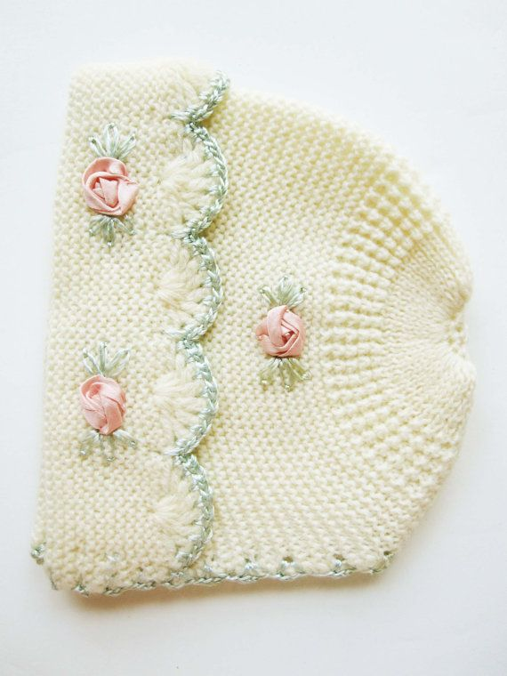 This is a really lovely knit hat with such wonderful detailing. The pink flowers are satin ribbon knots. The head size is 16 or smaller. It could easily have ribbons added for a tight fit. Its lovely to look at and study the quality. You could also use it to dress a large doll, re-purpose, hang on a vintage hanger or display in other ways. You are the designer. Lovely, vintage clothes