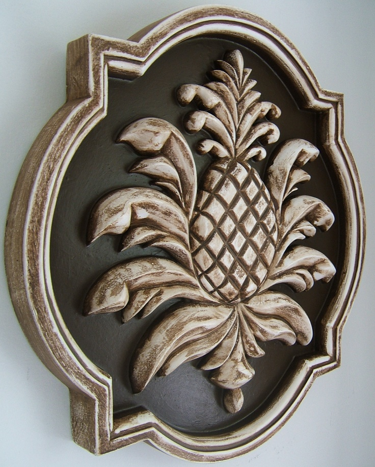 """Outdoor Pineapple plaque 24"""" shown in vintage brown by Marie Ricci."""