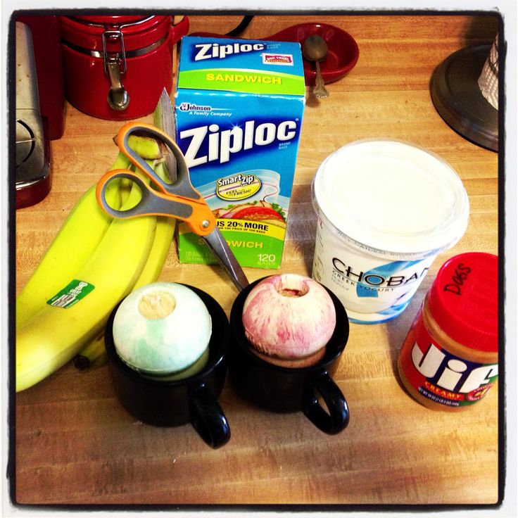 """Homemade kong toy filler. Much cheaper than buying the kong spray. Bananas, plain Greek yogurt, and creamy pb all blended. I put it in a ziplock bag and then snip off a corner to make my own """"pastry bag"""". Put the kong toys in mugs makes filling and freezing easier. Plus, my dogs love it!"""