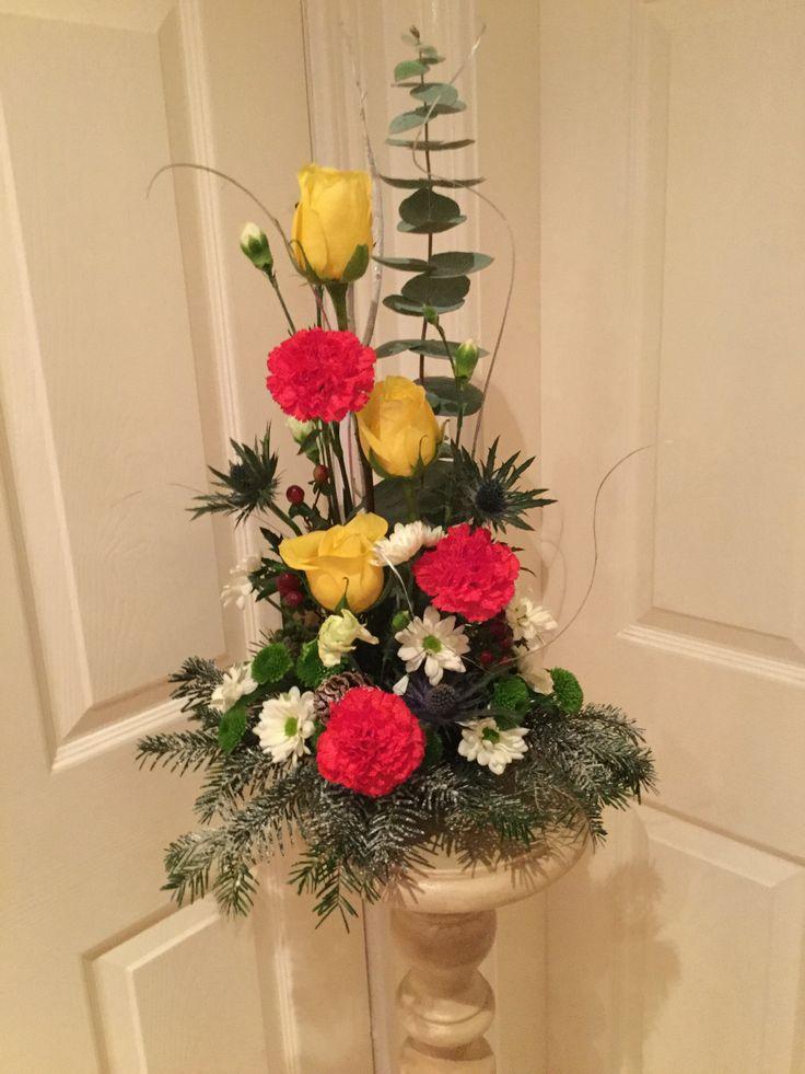 Roses,carnations and chrysanthemum arrangement.