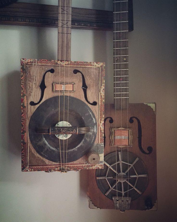 Two resonator cigar box guitars created by Michael Ballerini.