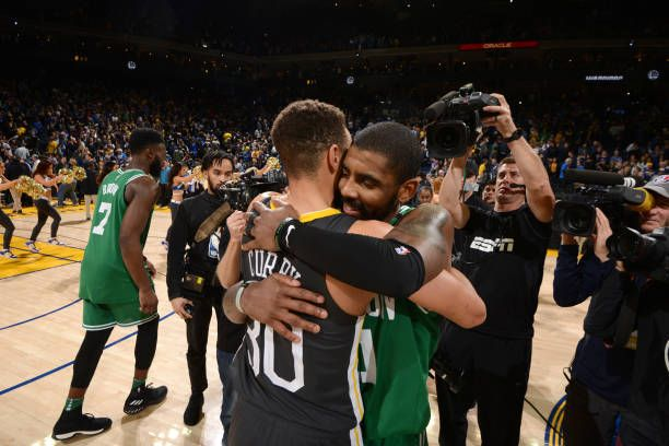 80dac6528036 Stephen Curry of the Golden State Warriors and Kyrie Irving of the Boston  Celtics hug after the game on January 27 2018 at ORACLE Arena in Oakland.