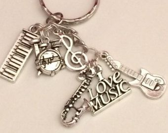 I love Music Keyring  Created by https://www.etsy.com/shop/FairwoodCreative   Inspired by the E Street Band with Guitar, Saxaphone, Drums, Keyboard & Treble Clef charms