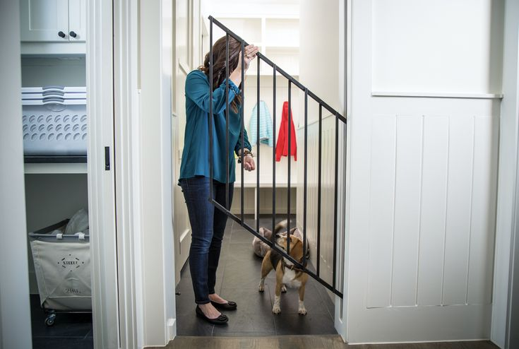 HIDEAGATE: An in-wall, retractable pet gate. This modern, durable, farm house style interior gate can be used as a dog gate or baby gate. Perfect for mudrooms, hallways, laundry rooms, and more.