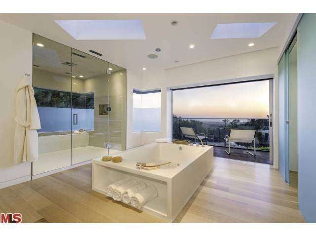 Image Gallery Website A spa like master bathroom with city and ocean views The huge glass enclosed shower