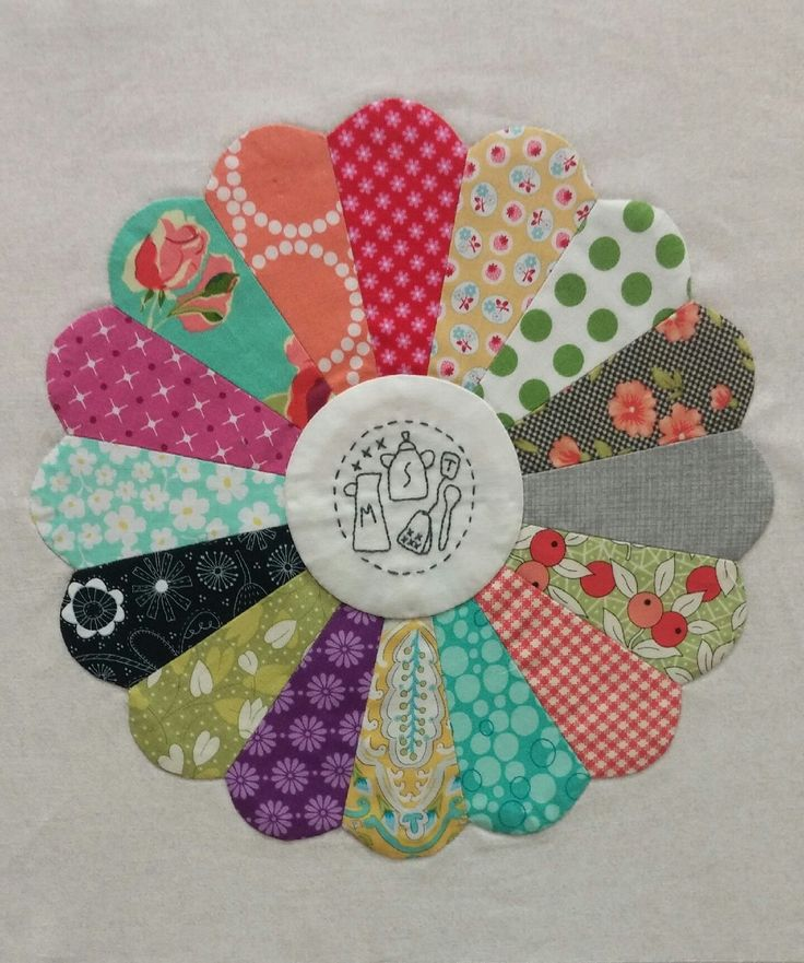 Dresden plate block with embroidery, Gossip in the Garden quilt at American Quilting