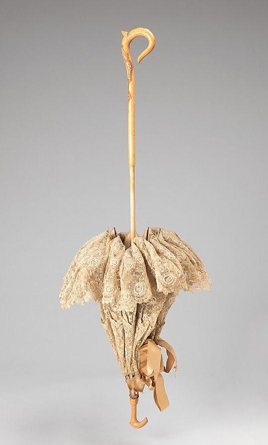 Parasol Date: 1880–90 Culture: American Medium: silk, wood, metal Dimensions: 37 3/4 in. (95.9 cm) Credit Line: Brooklyn Museum Costume Collection at The Metropolitan Museum of Art, Gift of the Brooklyn Museum, 2009; Gift of Euphemia C. van Holland in memory of Mrs. Henry van Holland, 1945