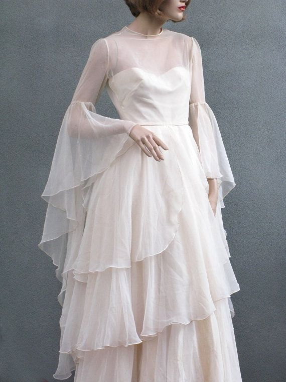 1970 39 s wedding dress with lovely tiered skirt and draping for Tiered wedding dress with sleeves