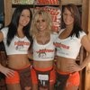 Hooters in Raleigh. Great wings. Good service. Uncomfortable bar stools. Lots of wide screen TV's that didn't inhibit table conversation.