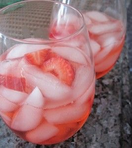 Strawberry Sangria  1750-ml bottle dry white wine  1/2 cup strawberry schnapps  1/4 cup sugar  2 cups sliced fresh strawberries  ice  whole strawberries  In a 2-quart pitcher, stir together wine, schnapps and sugar until the sugar is dissolved. Add sliced strawberries. Cover and refrigerate at lease one hour. Serve in glasses over ice. Garnish with whole strawberries.
