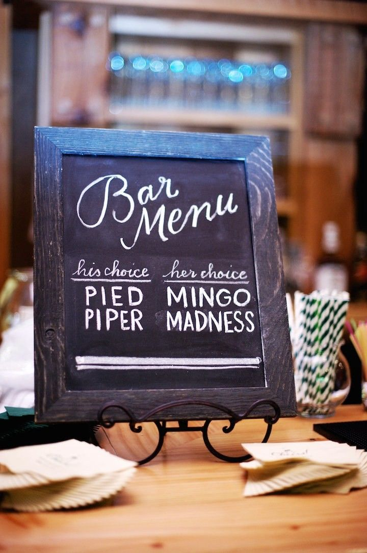 Rustic chalkboard sign for signature wedding drink choices at reception bar.