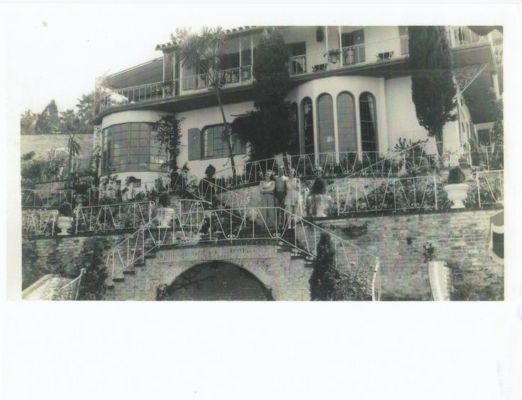 Demolished in the early 1950's for the Hollywood Freeway, Rudolph Valentino's Whitley Heights home was later owned by the founder of the Maybelline cosmetics empire. This rare view is from the rear. Foundation elements for the home remain embedded in the hillside today.