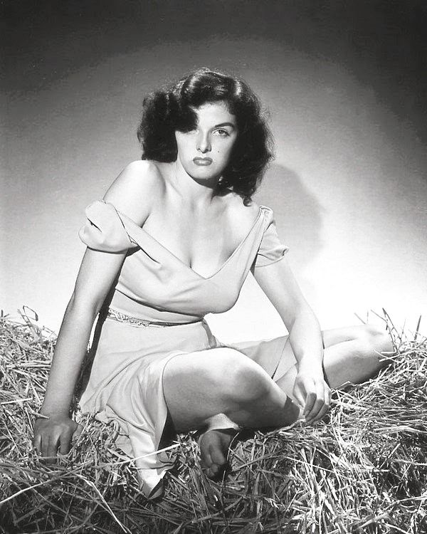 We Had Faces Then - Jane Russell in the notorious photo shoot she did for The Outlaw (Howard Hughes, 1943) The film was actually shot in 1941 but couldn't get Production Code approval because of Russell's bra-less breasts. It was released for a week in 1943 until the Code shut it down, and it was not until 1946 that the film was finally and widely released.