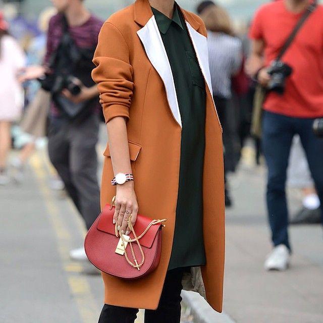 A red hot look of an orange overcoat and crimson Chloe Drew handbag! #LFW