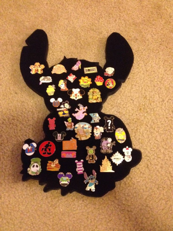 Stitch Disney Pin Collector Display.  Can hold about 45 pins by PinDisplaysPlus on Etsy https://www.etsy.com/listing/169648500/stitch-disney-pin-collector-display-can
