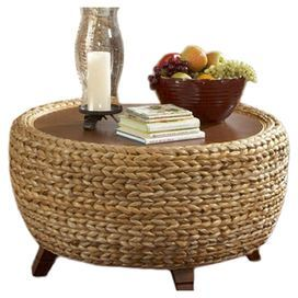 "Drum coffee table with plaited seagrass sides and a wood top.  Product: Coffee tableConstruction Material: Wood and seagrassColor: NaturalFeatures: Part of the Paradise CollectionDimensions: 18"" H x 34"" Diameter"