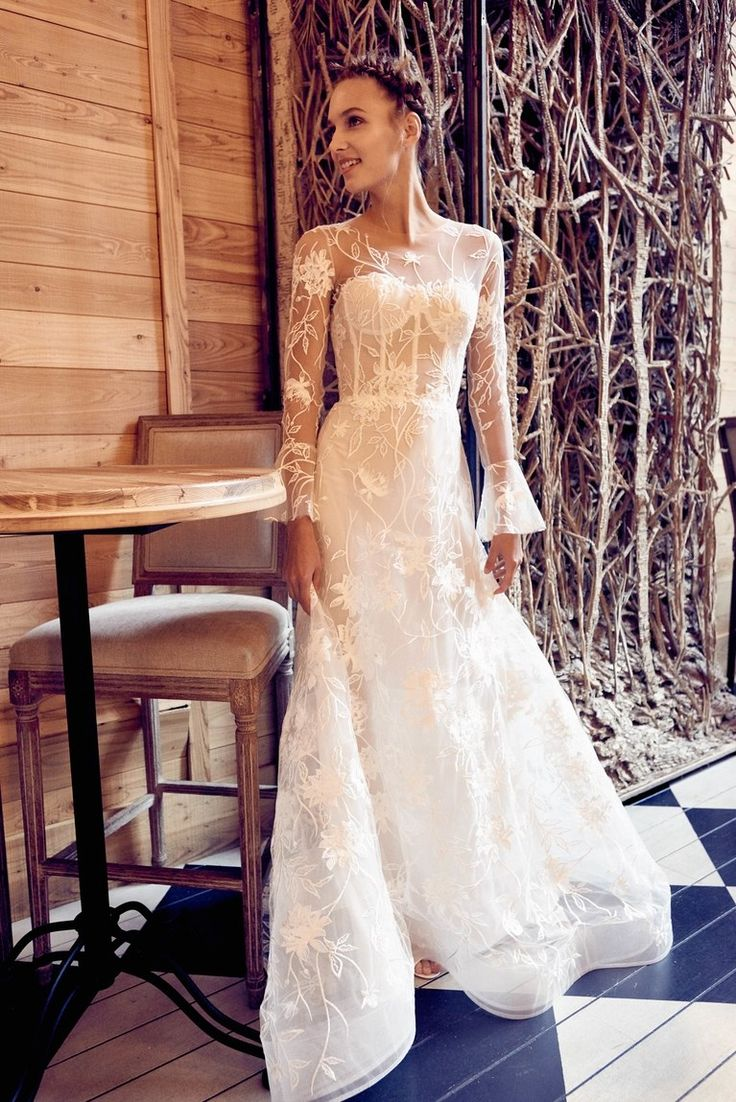 Wedding dress by [Isabelle Armstong](https://www.brides.com/photo/wedding-dresses/designer/isabelle-armstrong?)