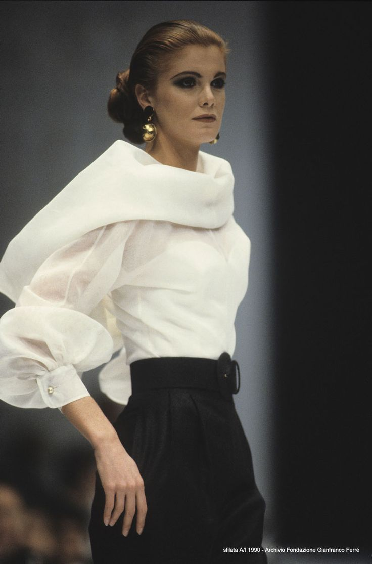 Classic Glamour A/W 1990 The fully backed collar is attached only to the front of the shirt in such a way that it is free to fall softly down the back of the wearer, recreating the classic elegance of 1950s couture.