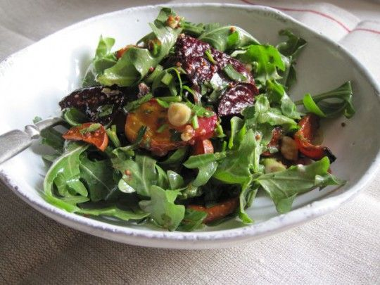 Wild arugula salad with roasted root vegetables, walnuts and mustard dressing