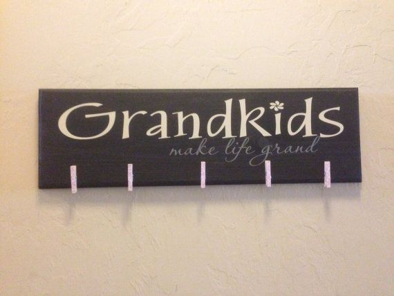 """SALE thru Fri 11/29 Grandkids -make life grand. Picture holder wooden plaque 8""""x24"""",  with up to 6 clothes pins. on Etsy, $20.00"""