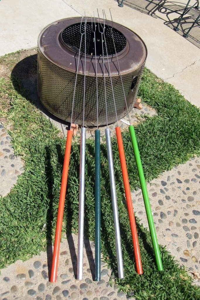 DIY marshmallow sticks, great for camping - these are made out of broom handles and wire clothing hangers. They are outstanding marshmallow forks because the wooden handle and overall length allowed one to sit back and roast a perfect marshmallow.