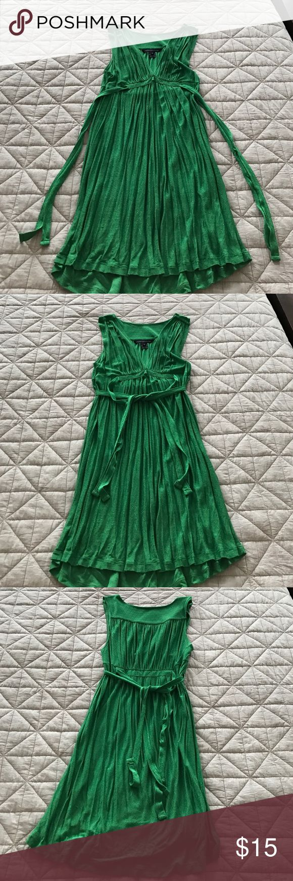 French Connection Empire Waist V-Neck Dress Beautiful vibrant green plunging v-neck dress by French Connection. Double tie on sides allow for tying in front back or sides. Drapey fit makes this a flattering and easy dress to wear. Perfect for any occasion. Can be worn alone or with tights or leggings. Good condition. French Connection Dresses