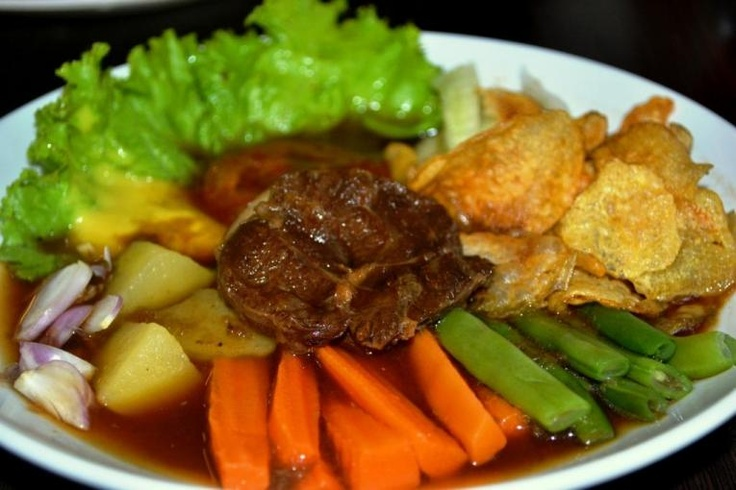 "Selat Solo. This food is the result of acculturation between Javanese and the Dutch culture during colonial period centuries ago. Javanese people call it ""selat"" but Dutch call it ""salad"". Different tongue, different spelling.   Basically this meal consists of beef, boiled potatoes, french fries, lettuce, carrots, green beans, tomatoes and onions doused with spicy sauce & home made mayonnaise."