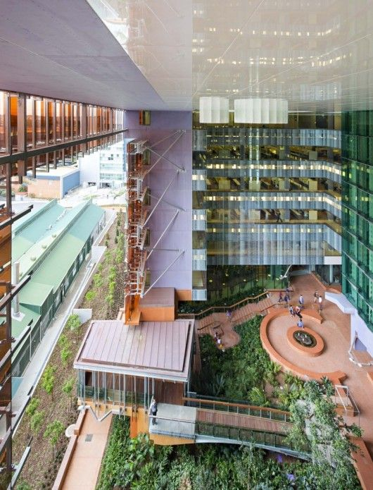 "The green ""atrium,"" open to the elements, is essential to the concept of the building. The laboratory spaces all look onto the atrium. On the ground level,"