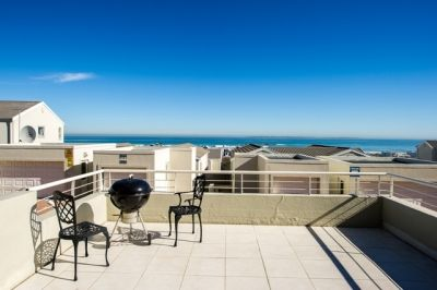 Bloubergstrand, Cape Town Self Catering Accommodation - The finest in accommodation. A magnificent sunny 2 Bedroom, en-suite Bathroom apartment on ground floor level that has a huge patio with built-in braai.