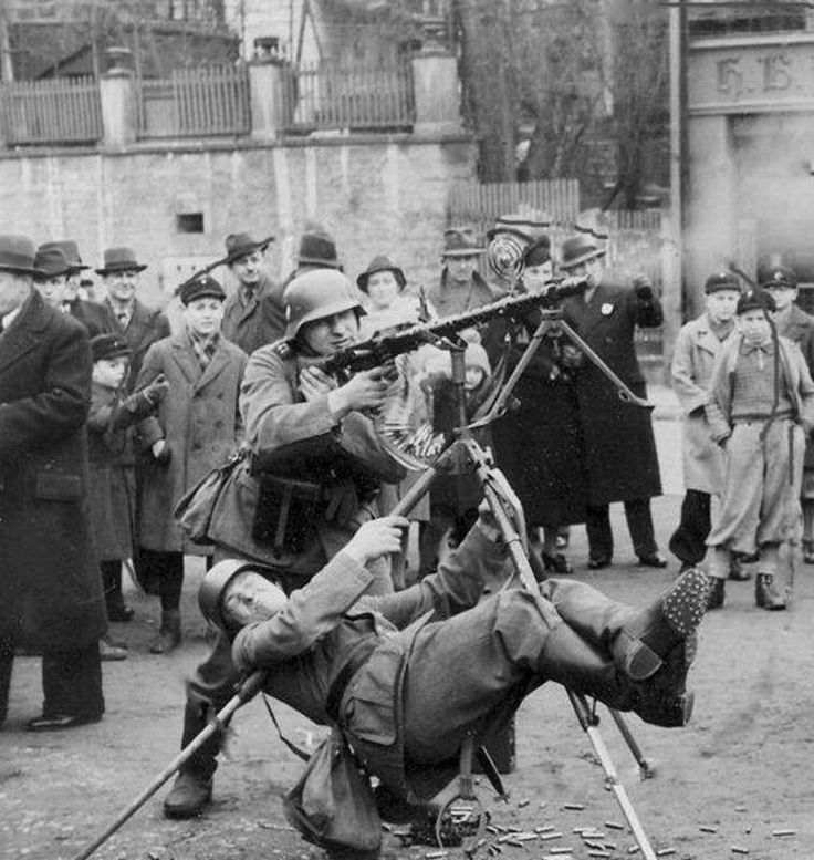 Wehrmacht (Heer) soldier using his body weight to stabilize an MG34 on an…