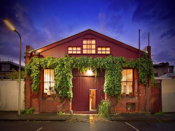 This original South Fitzroy, Victoria, Australia artist's warehouse conversion has been the longtime home and studio to a renowned painter.