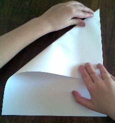 cool idea - folding a paper cross - torn pieces spell LIFE