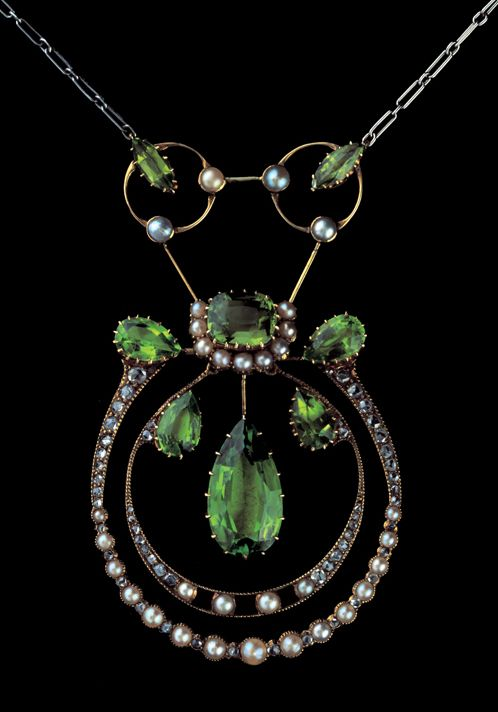 ARCHIBALD KNOX 1864-1933 Rare Liberty & Co Pendant  Gold Silver Peridot Pearl Diamond H: 6.5 cm (2.56 in)  W: 4 cm (1.57 in)  British, c.1900
